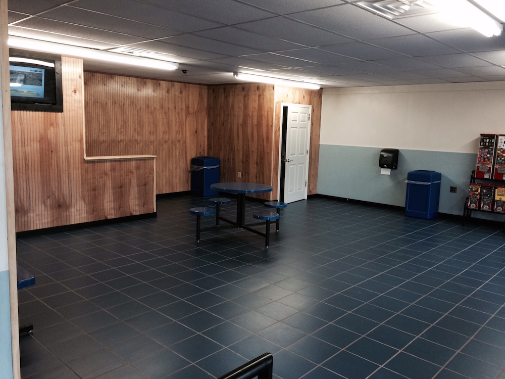 TV and waiting area with snacks available | Tanyard Rd Laundry Land Laundromat