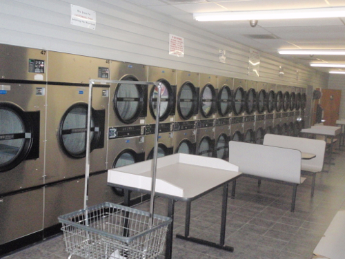 Large row of dryers, and plenty of folding tables