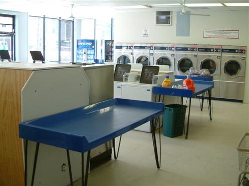 Plenty of folding tables available | Smithfield Main Street Coin Laundry