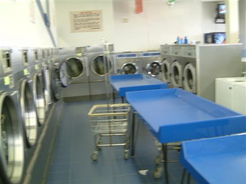 Plenty of dryers and folding space | Squire Armory Laundromat in Danville, VA
